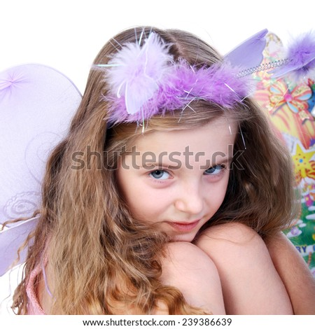 cute little girl in the costume of the butterfly