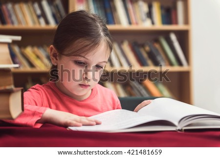Cute Little Girl in the Library - Reading Habit