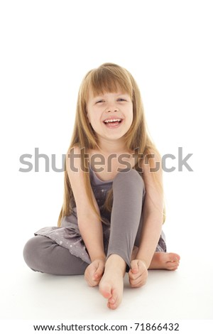 Cute little girl in the studio on white background - stock photo