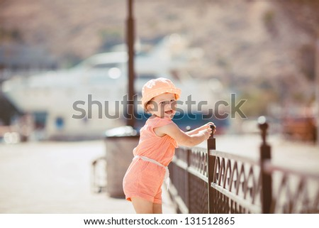Cute little girl in the summer outdoor - stock photo