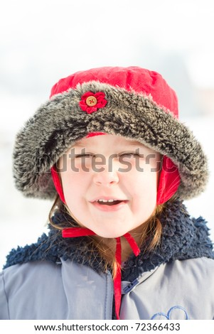 cute little girl in warm clothes