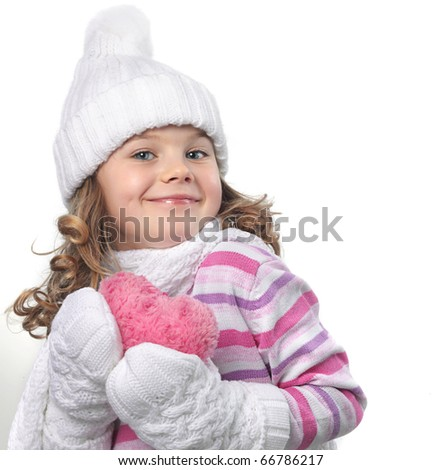cute little girl in warm clothes on white background with heart - stock photo