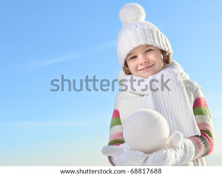 cute little girl in warm clothes outdoors - stock photo