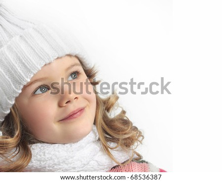cute little girl in warm hat and gloves with figure skates on white background - stock photo
