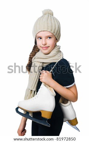 cute little girl in warm hat with figure skates on white background