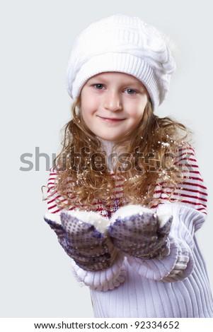 Cute little girl in winter wear happy about new year - stock photo