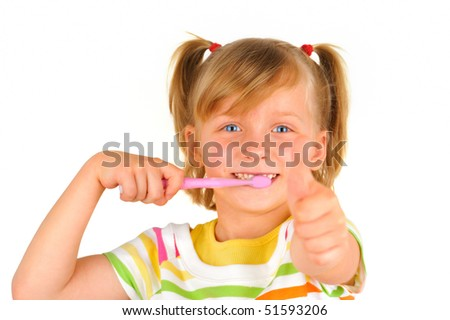 Cute little girl is brushing teeth with a smile