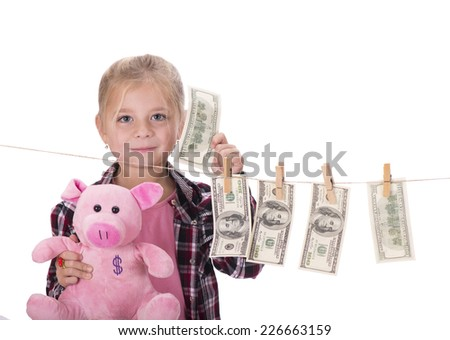 Cute little girl is playing with paper money - dollars, isolated over white  - stock photo