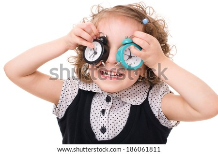 cute little girl is playing with wakes up, isolated on white background - stock photo