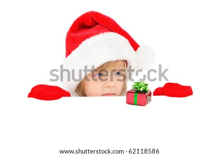 Cute little girl is sad because of small Christmas gift - stock photo