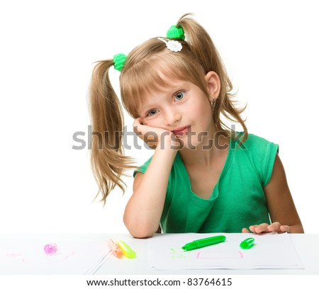 Cute little girl is tired with drawing while sitting at table, isolated over white