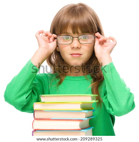 Cute little girl is wearing glasses, isolated over white - stock photo
