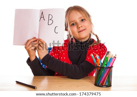 Cute little girl is writing  - stock photo