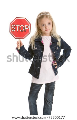 Cute little girl isolated on a white background holding a stop sign - stock photo