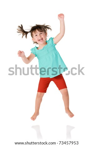 Cute little girl jumping with joy isolated on white background - stock photo