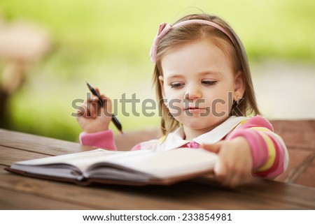 cute little girl learning to write - stock photo