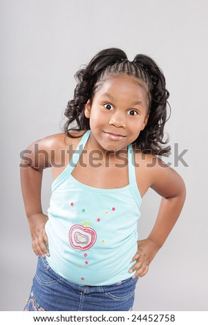 Cute little girl looking excitedly at the camera - stock photo