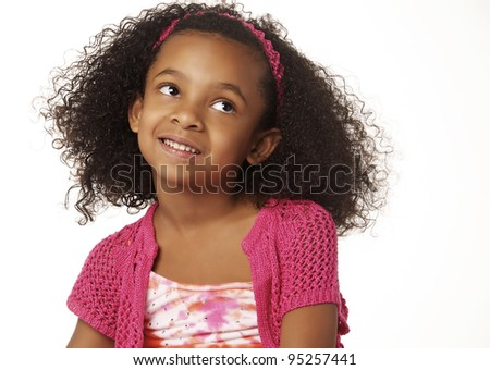 Cute little girl looking to side. - stock photo