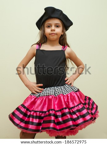 Cute little girl made up as a pirate - stock photo