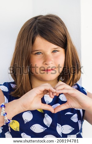Cute little girl making hands heart - stock photo