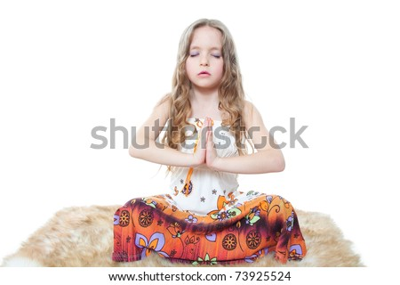cute little girl meditating isolated on white