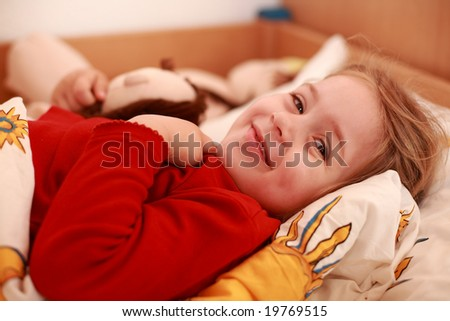 Cute little girl morning in the bed - stock photo
