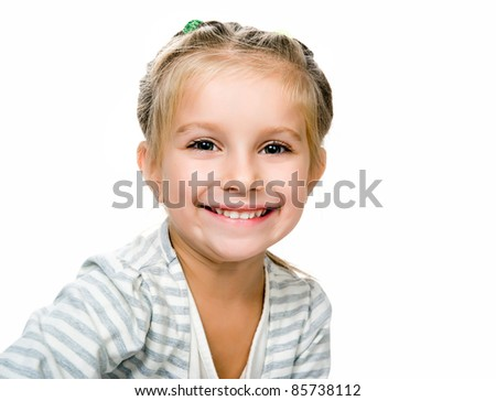 Cute little girl on a white background close-up - stock photo