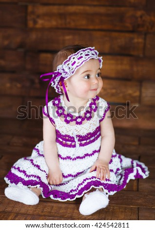 Cute little girl on a wooden background. - stock photo