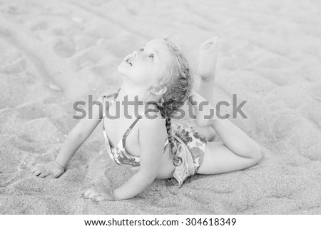 cute little girl on the beach stretch ( black and white )