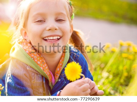 Cute little girl  on the meadow in spring day - stock photo