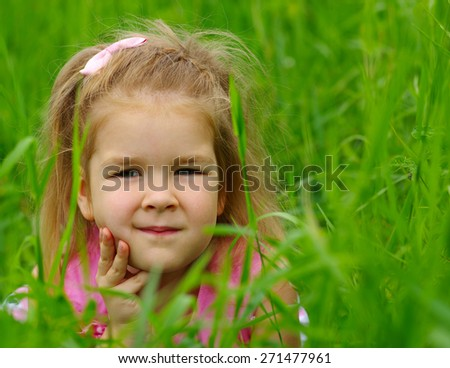 Cute little girl on the meadow in spring day. Child running on field . Child with arms outstretched. Freedom concept. - stock photo