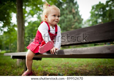 cute little girl outdoors in a park - stock photo
