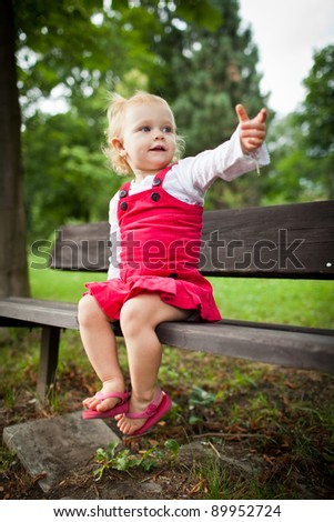 cute little girl outdoors in a park