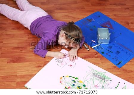Cute little girl painting on the floor - stock photo