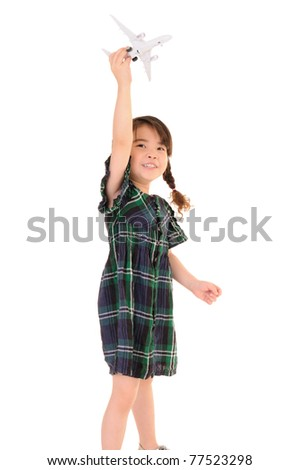 Cute little girl play with toy airplane on white background - stock photo