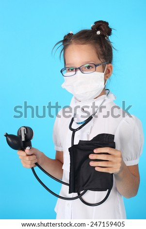 cute little girl playing a doctor