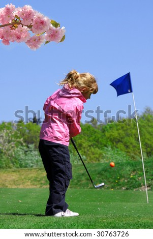 cute little girl playing golf - stock photo