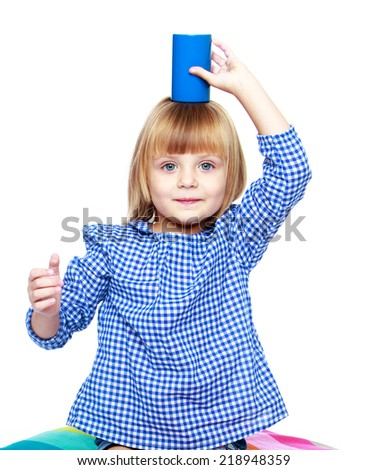 Cute little girl playing on the head to keep the blue barrel, isolated on a white background.Education concept happy child. - stock photo