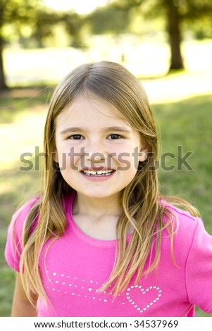 Cute little girl playing outside - stock photo