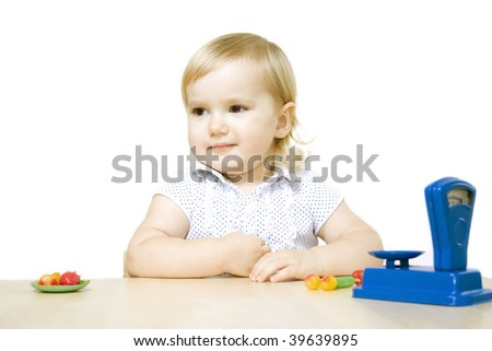 Cute little girl playing toy shop
