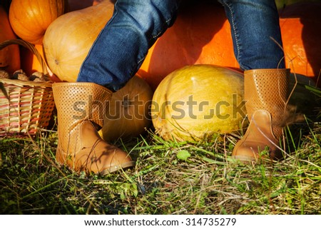 Cute little girl playing with a harvest - stock photo