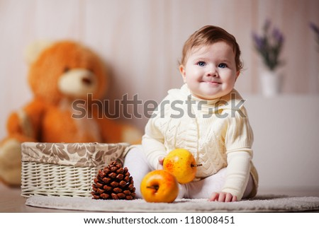 Cute little girl playing with apples