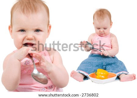 cute little girl playing with big spoon. Isolated on white background