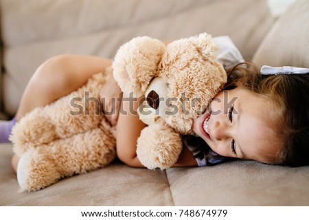 Little Girl Sleeping Hugging Her Teddy Stock Photo