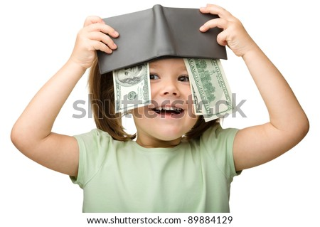 Cute little girl plays with money, isolated over white - stock photo