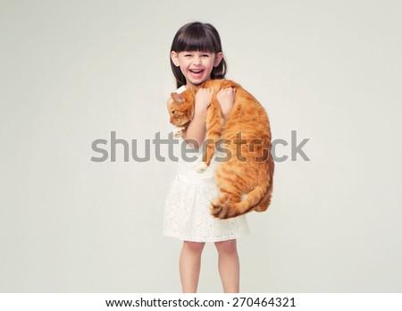 Cute little girl portrait hug red cat smiling  - stock photo