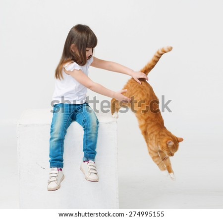 Cute little girl portrait hug red cat smiling