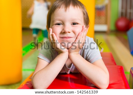 Cute little girl portrait in daycare gym - stock photo