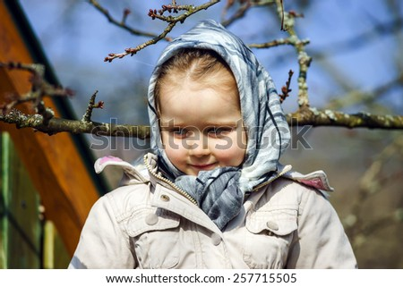 Cute little girl portrait , spring day, playground, sunny weather