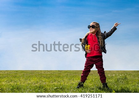 Cute little girl posing as a rock star - stock photo